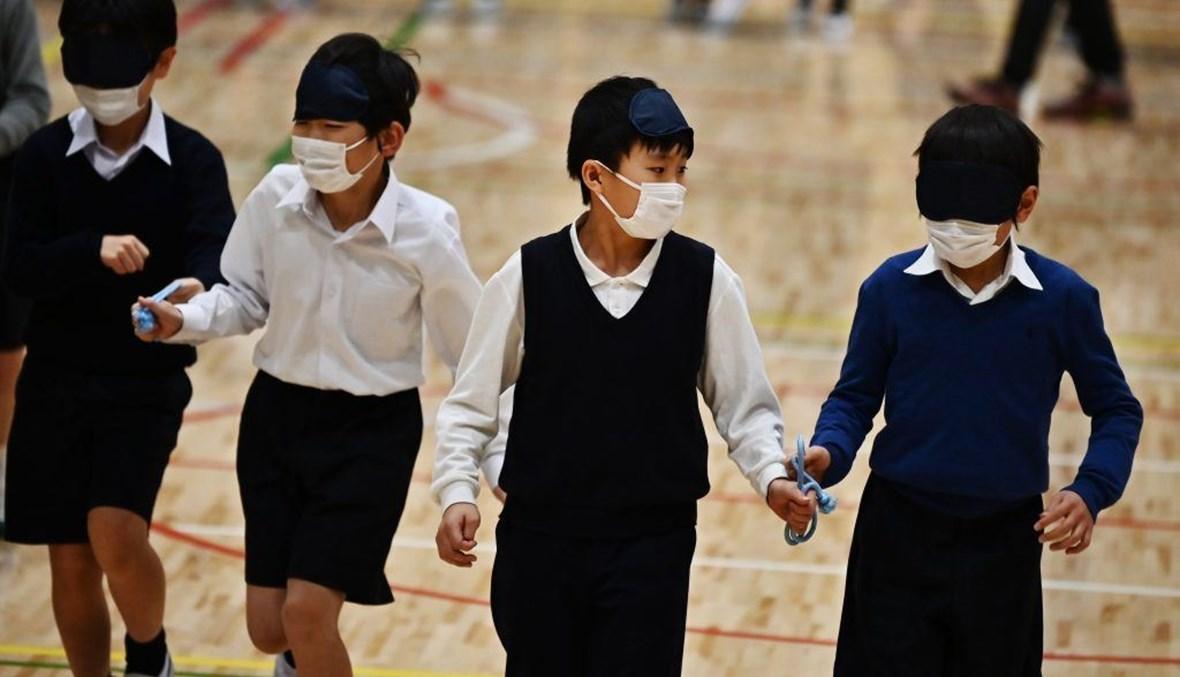أطفال في اليابان (أ ف ب).