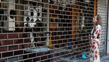 زجاج المحال المحطَّم بعد أحداث الطيونة - عين الرمانة (النهار).