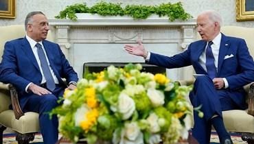 """الرئيس الأميركي جو بايدن مستقبلاً رئيس الوزراء العراقي مصطفى الكاظمي، 26 أيلول 2021 - """"أ ب"""""""