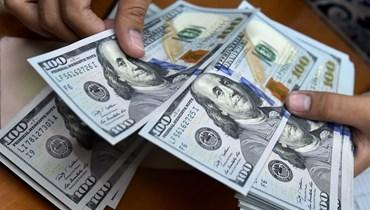 الدولار (تعبيرية- أ ف ب).