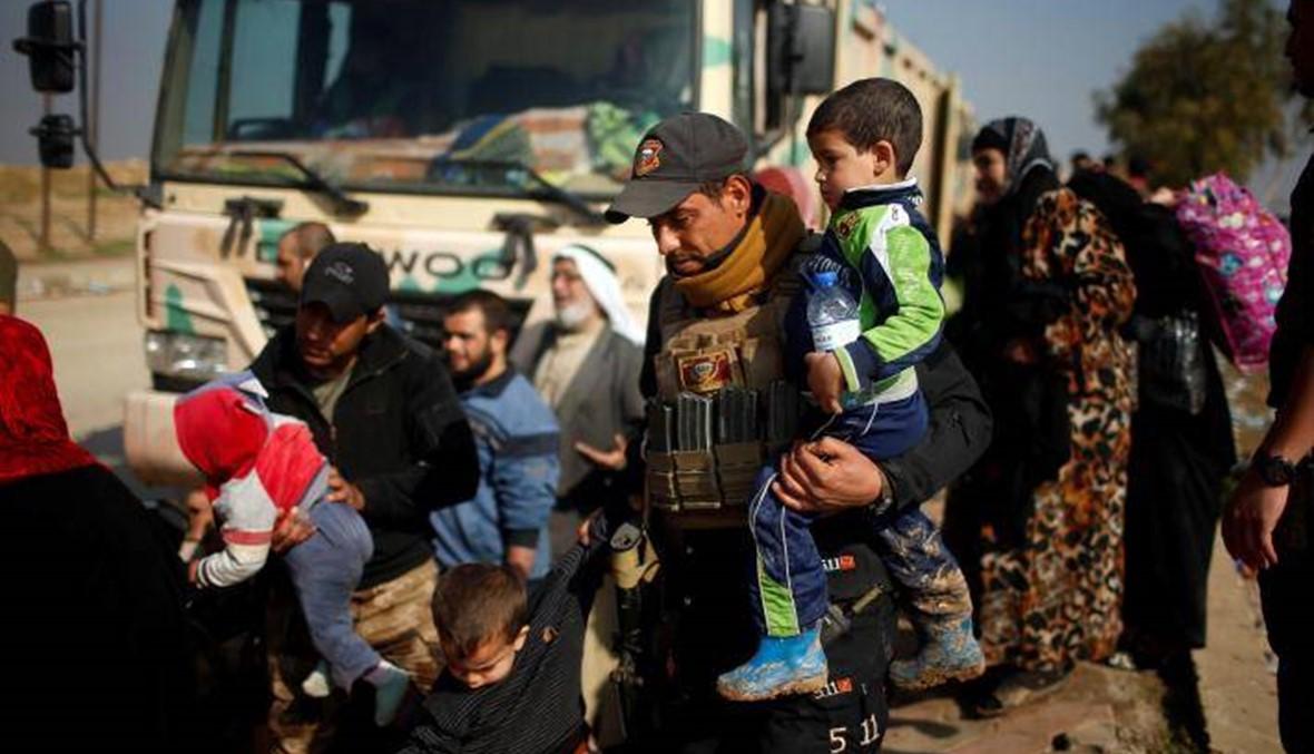 في الموصل... عشرات الآلاف يكافحون للحصول على غذاء وماء ودواء
