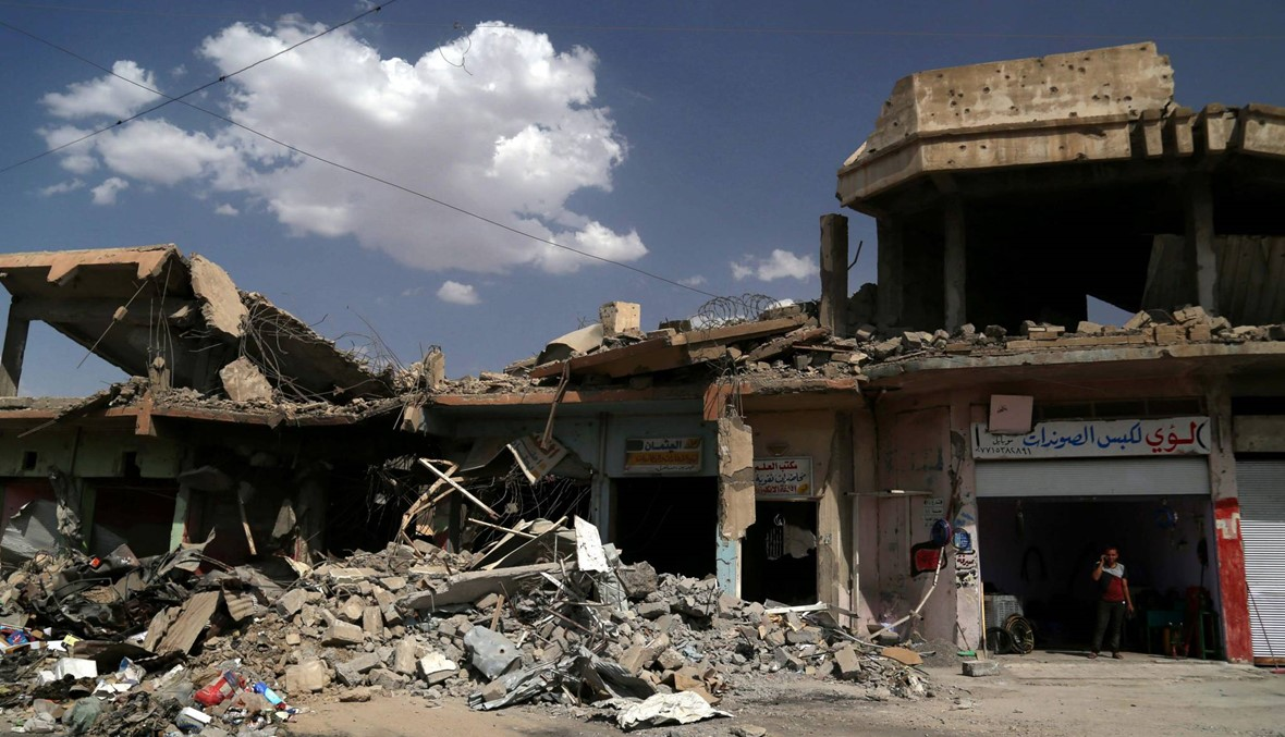 """الموصل: سكان يبحثون عن جثث أقاربهم بين الأنقاض... """"لم تبقَ إلا كومة حجار"""""""