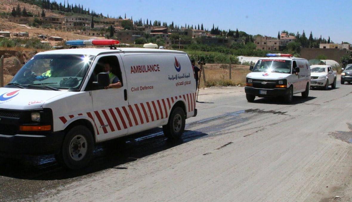 """بالصور- وصول أول قافلة تقلّ جثامين """"النصرة"""" إلى اللبوة"""
