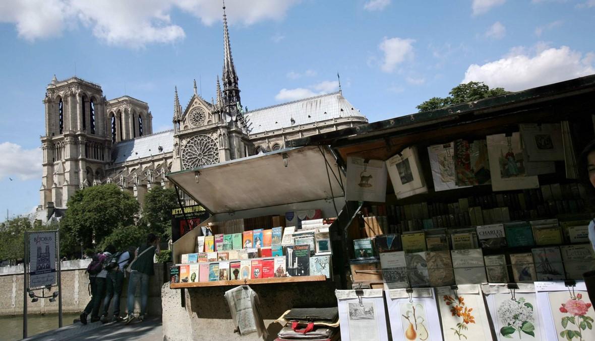 """""""في باريس لدينا برج إيفل ومونتمارت وصناديقنا الخضراء هذه"""""""