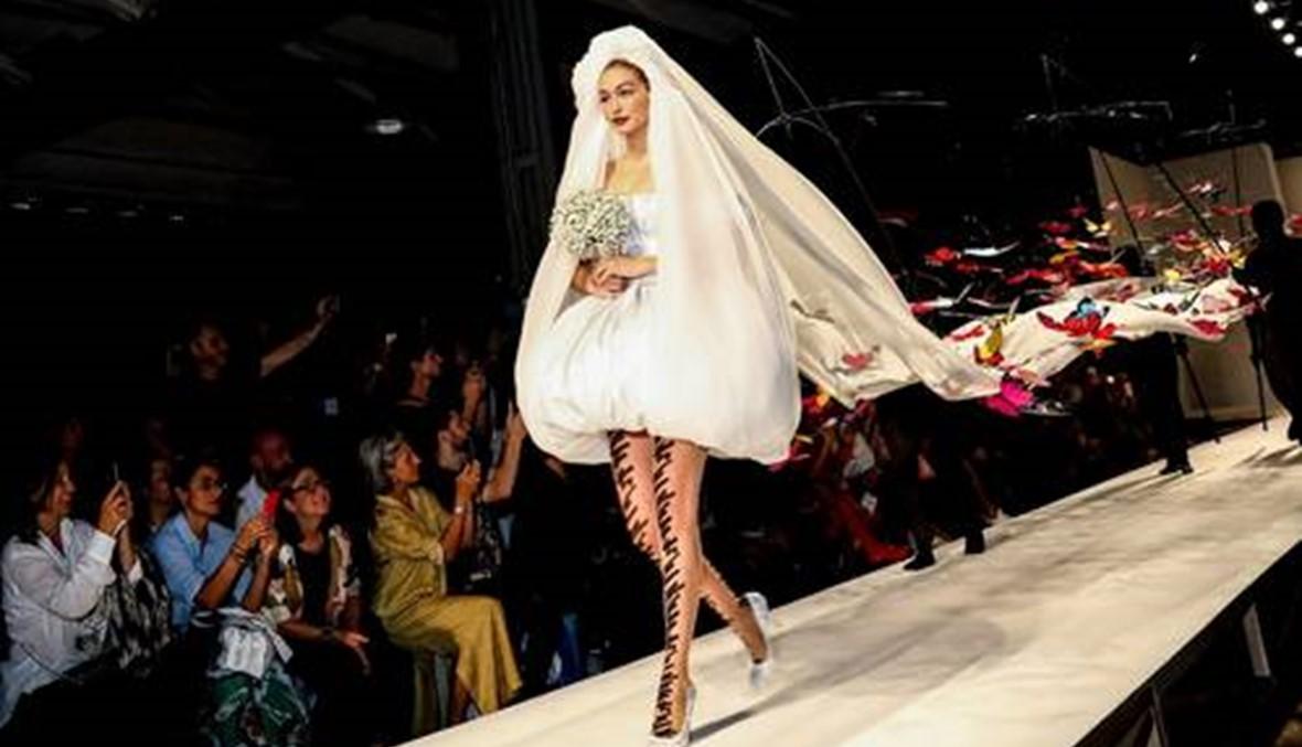 جيجي حديد ترتدي فستان الزفاف في ميلانو  وأختها بيلا تبكي