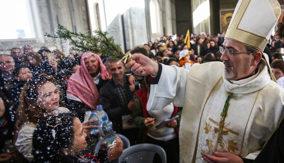 """""""يوم الحج الكاثوليكي والوطني إلى المغطس""""... مئات شاركوا في قداس عند نهر الأردن"""