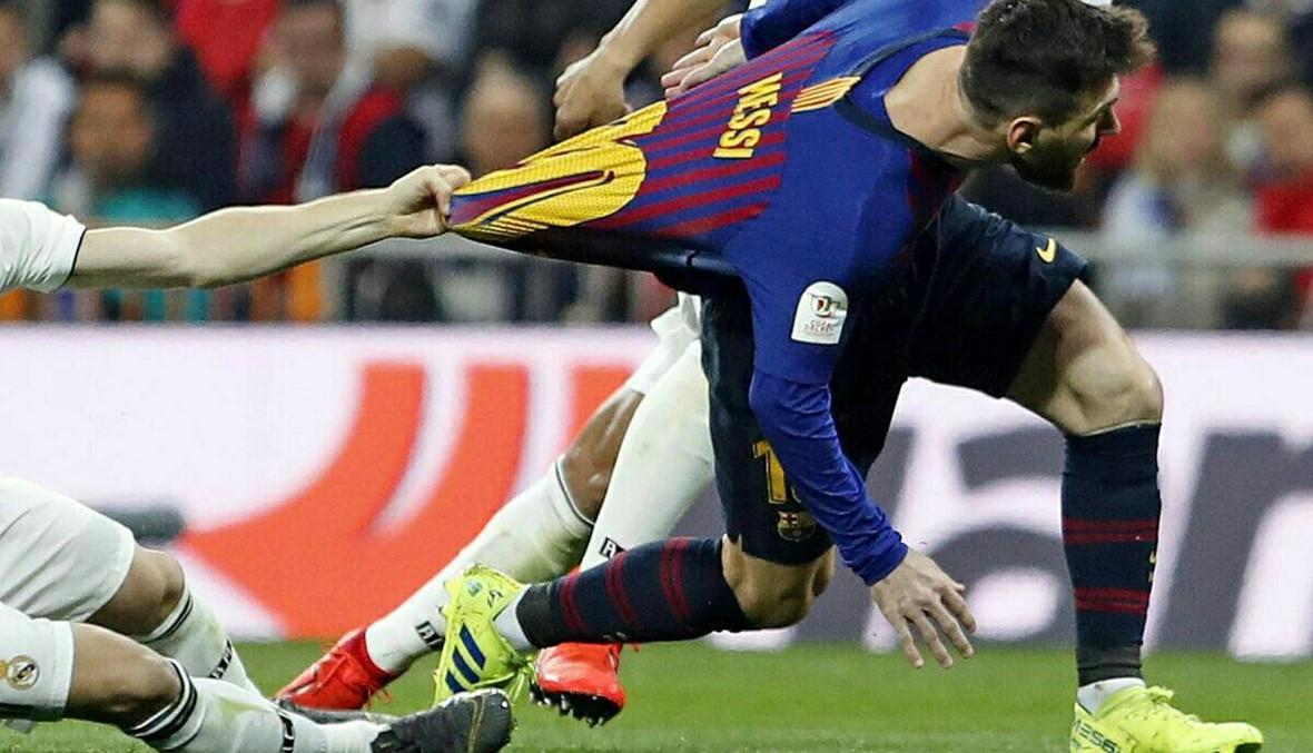 بالصور: برشلونة يسخر من مودريتش... وجماهير ريال مدريد ترد