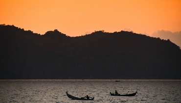 غروب الشمس في اندونيسيا (أ ف ب).