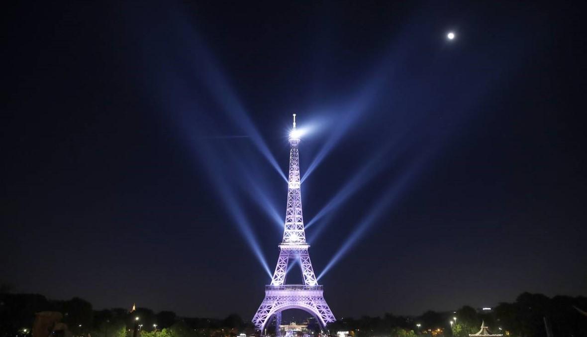 باريس تحتفل بذكرى مرور 130 عاماً على إنشاء برج إيفل