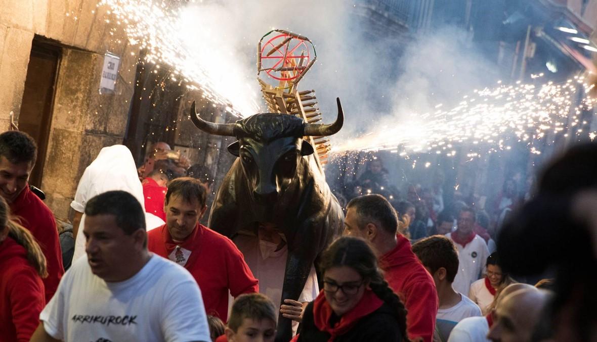 مهرجان سان فيرمين في اسبانيا (أ ف ب).
