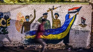 """إزالة جداريات لمحتجي الخرطوم... """"طمس أحد أهم ملامح الثورة"""""""