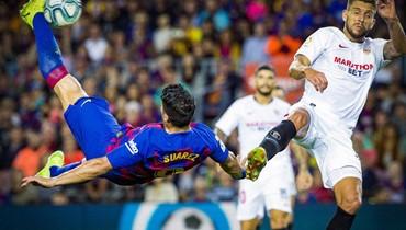 برشلونة يكتسح إشبيلية ويخسر بيكيه وديمبيلي