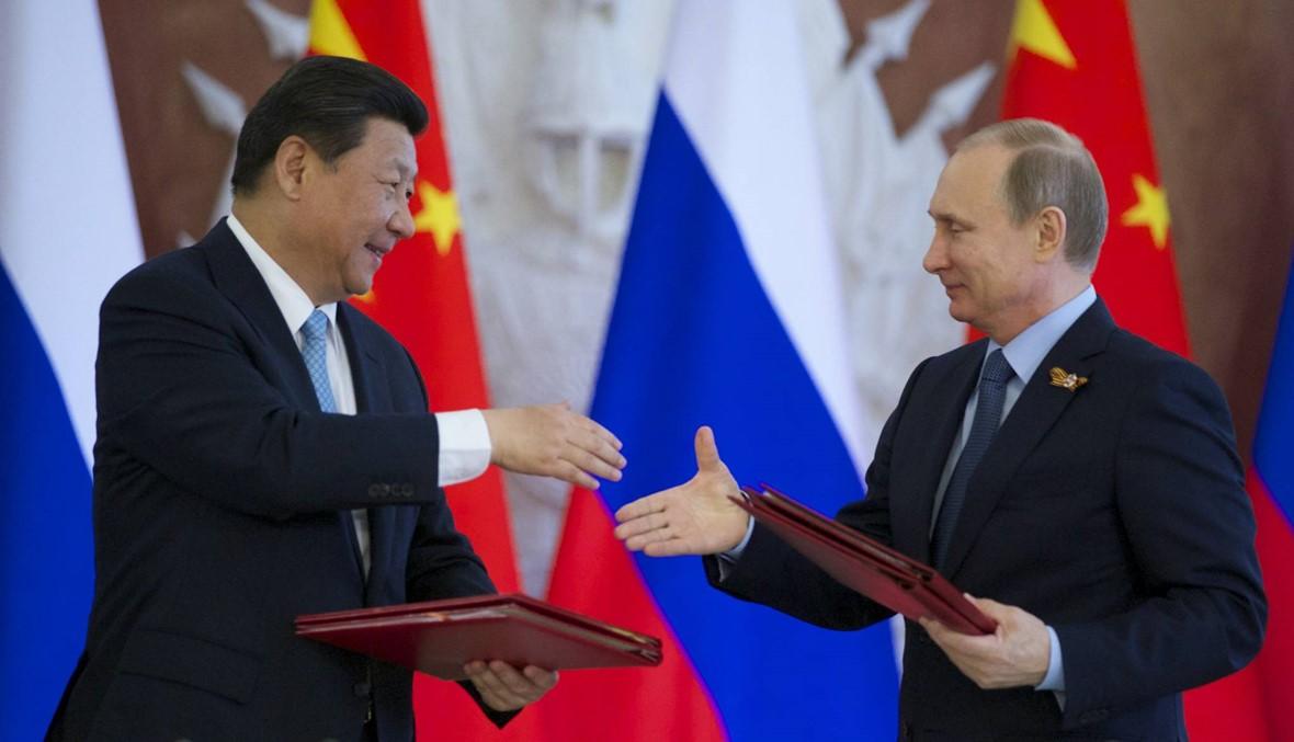 """هل تدفع الاحتجاجات الدولية روسيا والصين إلى """"الجانب الخطأ من التاريخ""""؟"""