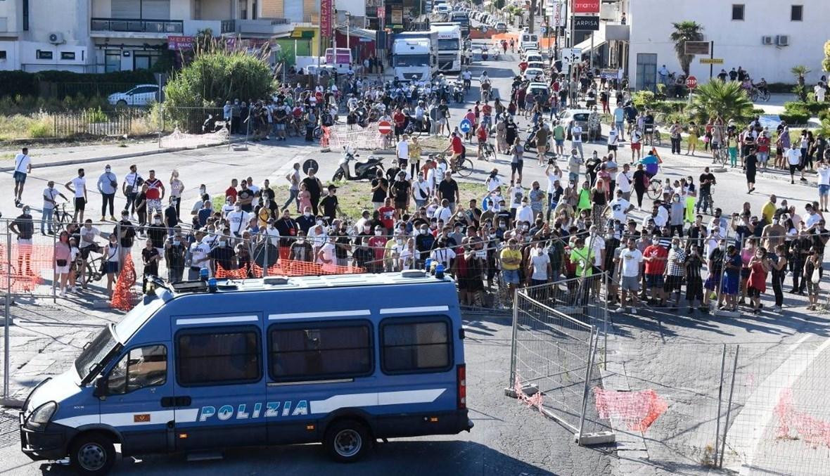 إيطاليا: مواجهات بين مهاجرين وسكان موندراغوني بعد تفشّ لكورونا في البلدة