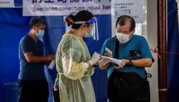 """""""الوضع الوبائي خطير جدّاً""""... هونغ كونغ تفرض وضع الكمامات في الأماكن العامة"""