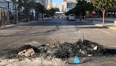 بالصور والفيديو: بعد احتجاجات الأمس في وسط بيروت... تكسير واجهات المحال واحتراق عظام أثرية