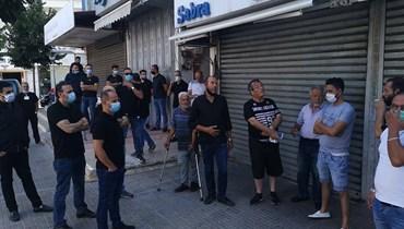 وقفة احتجاجية لتجار النبطية... مطالبة بالسماح بفتح محالهم جزئياً (صور)