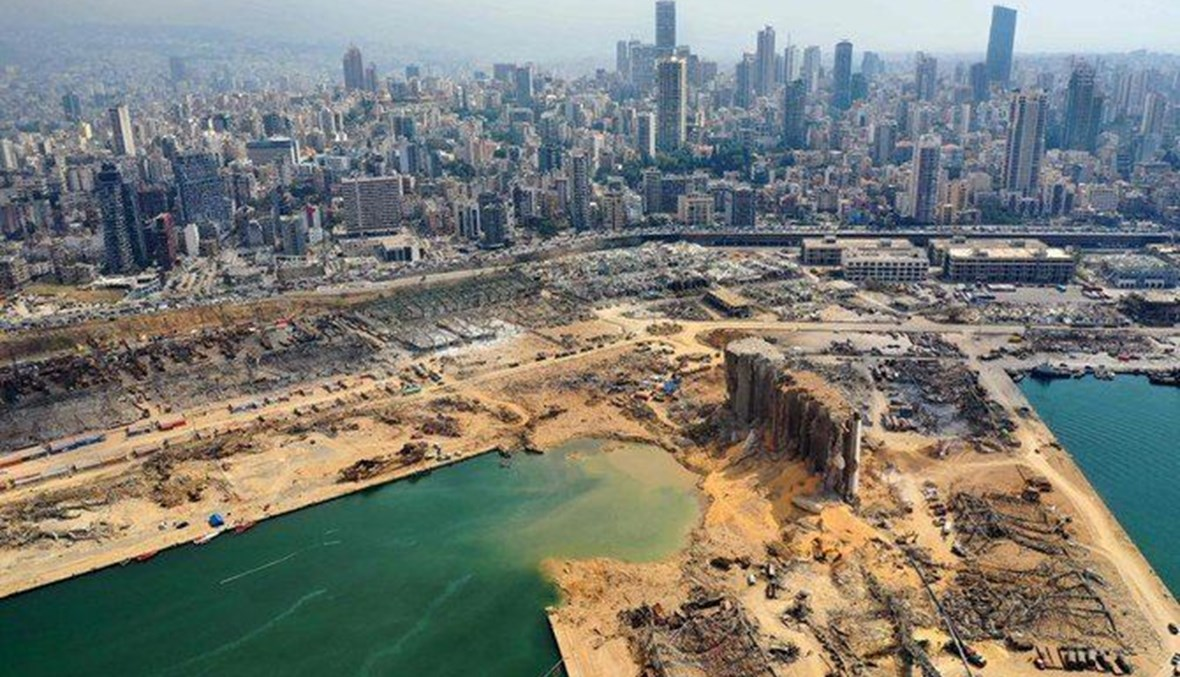 Above, an aerial view taken on August 7, 2020 shows a partial view of the port of Beirut and the crater caused by the explosion. (AFP)