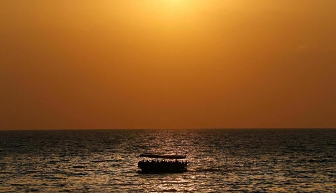 A boat carrying migrants sails off the coast of the northern Lebanese city of Tripoli. (AP Photo)